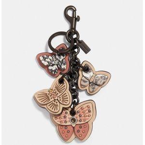 Coach butterfly cluster bag charm snakeskin peach